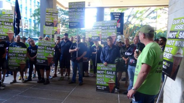 Protesters speak out against asset sales at Parliament House.
