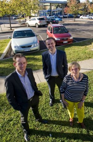 Shane Rattenbury, Minister Andrew Barr and Pat McGinn are pleased with car parking upgrades as part of the Weston Creek ...