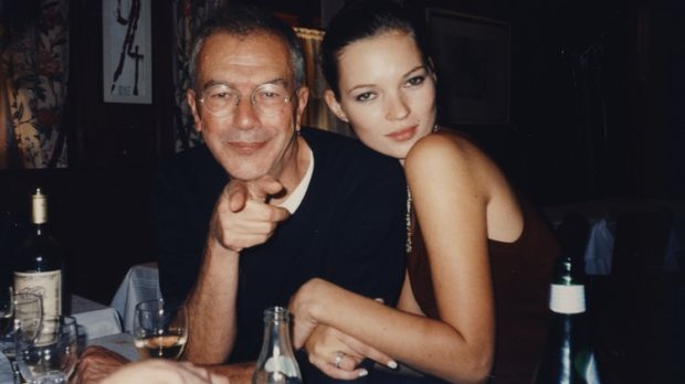 Michael White, the most famous man you've never heard of, with English model Kate Moss.