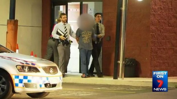 The man accused of trying to snatch a toddler from a Brisbane shopping centre leaves Stafford police station in handcuffs.