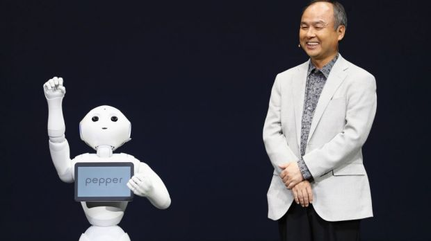 Softbank's Masayoshi Son with emotion-deciphering robot Pepper.