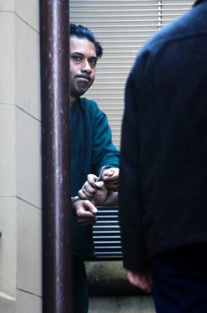 Suresh Nair is led from the King Street Supreme court after having bail denied.