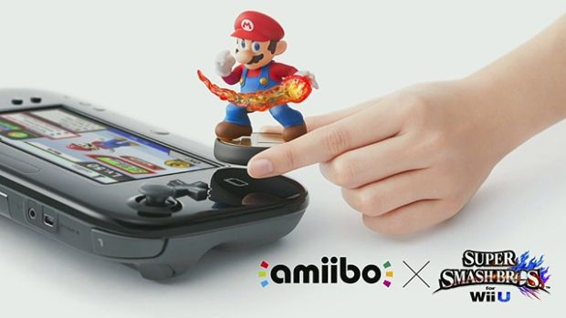 A Mario Amiibo figurine is used with <i>Super Smash Bros for Wii U</i>.