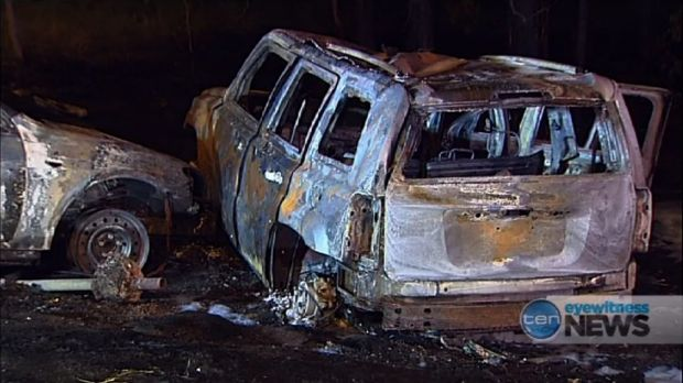 Police pulled four people from this 4WD before it burned.