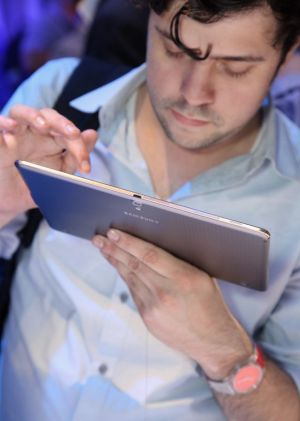 A guest uses the Galaxy Tab S at Samsung's launch event.