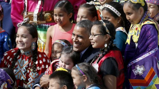 President Obama poses with Native America dancers.