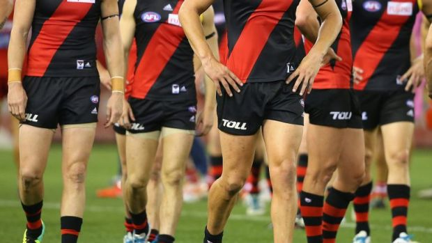 Essendon players after losing to Sydney in round nine.