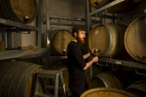 Wig and Pen duty-manager, Finn McGrath in the brew-pub's barrell-aging room.