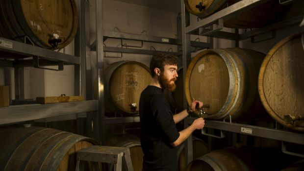 Wig and Pen duty-manager, Finn McGrath in the brew-pub's barrell-aging room, in the basement of Canberra House. The ...