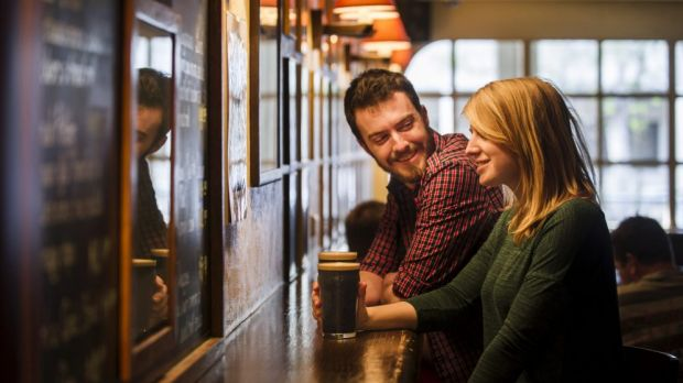 Andrew Deakins and Anna Trundle from Turner enjoy a Stout at the Wig and Pen on Sunday.