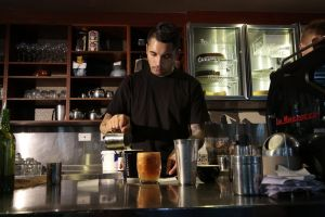 Jamie Morris behind the counter at Gus' Cafe in Civic.