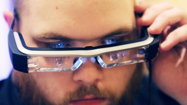 The Moverio smart glasses project two identical 16:9 images onto the lens-based screens, generating a semi-transparent ...