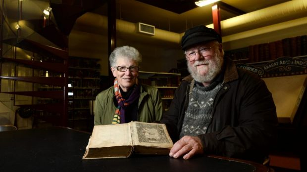 Volunteer Marion Blythman and Roger Burrows with the 1585 Breeches Bible.