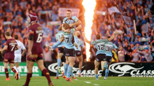 The Blues celebrate their 2014 State of Origin series win.
