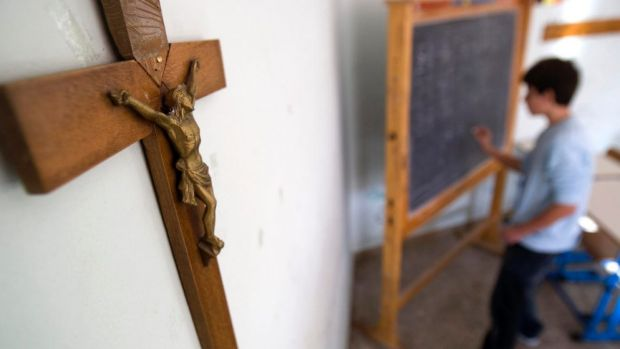 The National School Chaplaincy Program was restricted to religious chaplains only by the Abbott government.
