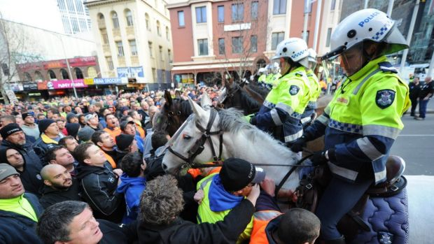 Police and striking CFMEU workers clash.