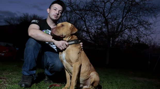 Justen Storay from Griffith with his dog Laps in his backyard. Laps was sprayed with capsicum spray by an ACT police ...