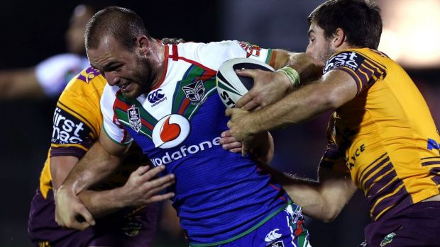 Simon Mannering tries to break the Brisbane line for the Warriors.