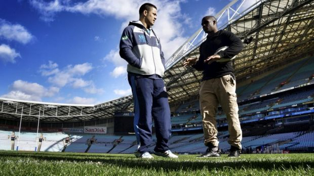 Jarryd Hayne meets NFL star Reggie Bush at ANZ Stadium in the lead-up to Origin II.