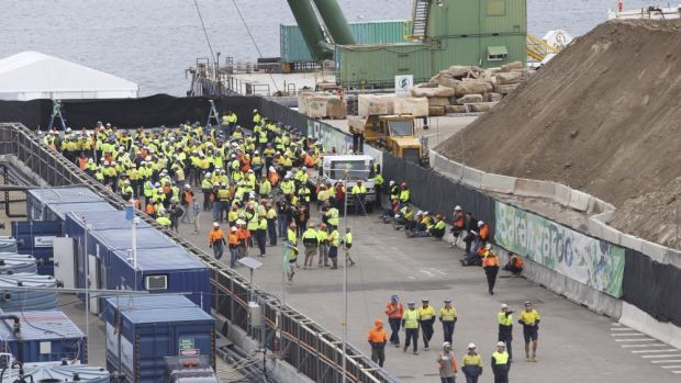 Construction workers leave the site.