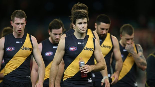 Richmond players leave the ground after another loss, this time to Sydney in round 14.