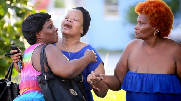 Bennae Robinson (centre), aunt of shooting victim Kevin Richardson, reacts to the death of her nephew who was gunned ...