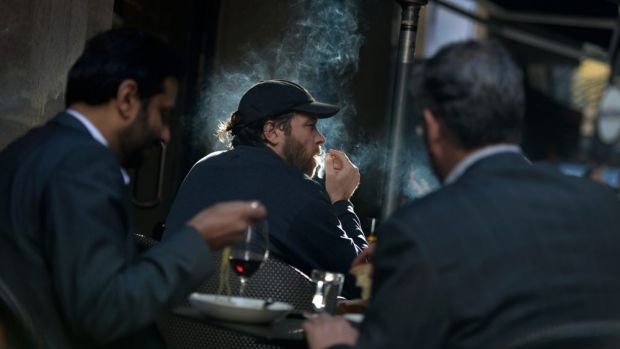 Smokers and diners mix in Degraves Street, Melbourne.