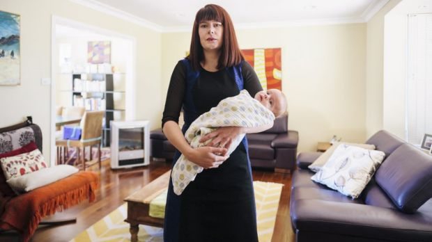 Brianna Heseltine and baby Marcus in their Weston home. She is the spokeswoman for the Fluffy owners and residents group,