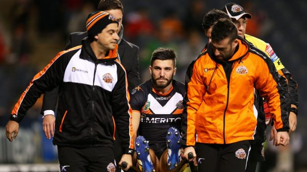 Wests Tigers fullback James Tedesco is stretchered off Campbelltown Stadium after injuring his knee against Canberra.