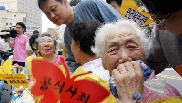 A former South Korean comfort woman Lee Sun-duk, right,  and other comfort women who were forced to serve for the ...