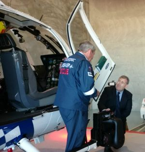 Police Minister Jack Dempsey inspects Polair 2 with Westpac Lifesaver Helicopter Rescue Service chief Pilot Peter Bird.