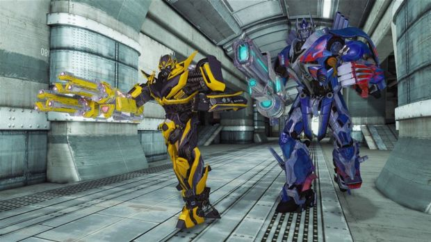 Bumblebee and Optimus Prime move out in <i>Transformers: Rise of the Dark Spark</i>.