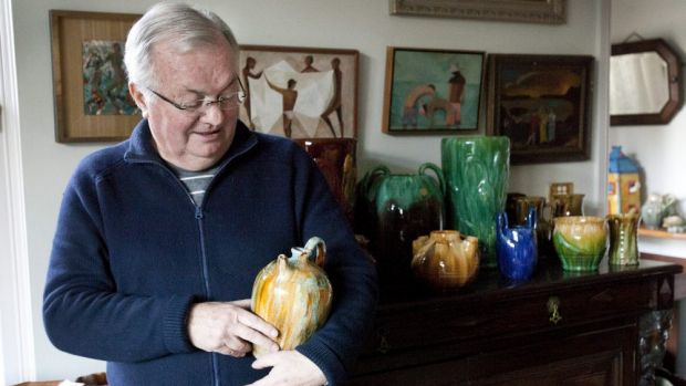 Kevin Power with part of his Tasmanian pottery collection at his Wollstonecraft home in Sydney.