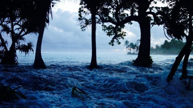 The Marshall Islands hit by king tides. It is one of the South Pacific nations researchers say are facing unaffordable ...