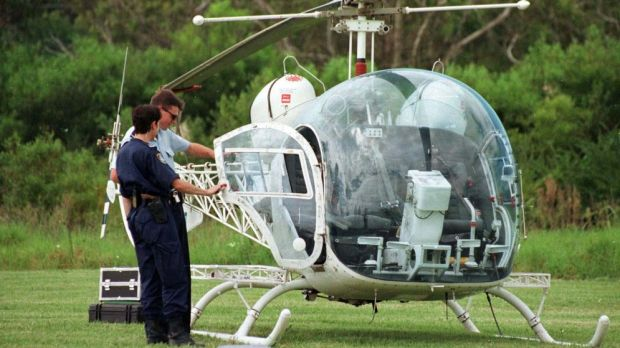 Police examine the helicopter used to break John Killick out of prison.