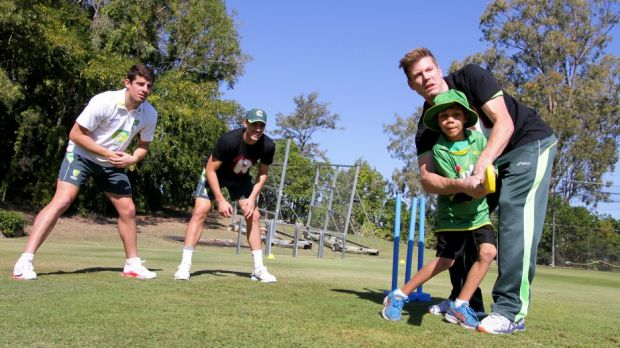 Carlin Renoug, 8, from Cherbourg gets some cricketing tips from cricketers James Faulkner, Moises Henriques and Pat ...