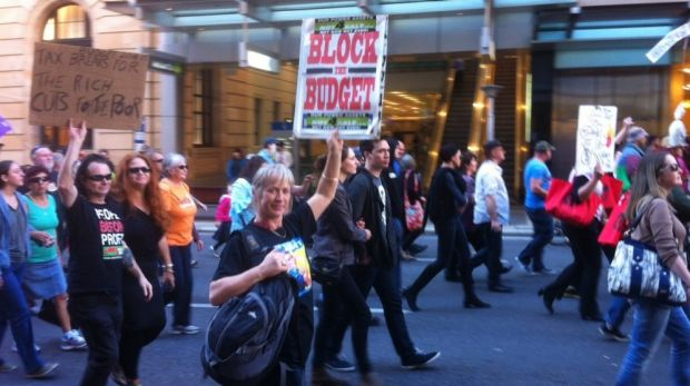 People take to the streets of Brisbane to protest over the Federal Budget.