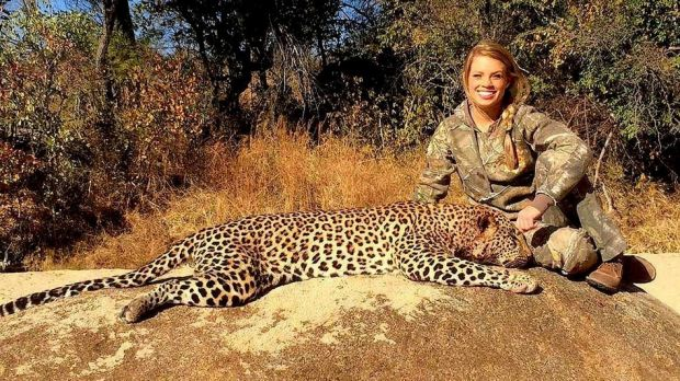 Kendall Jones posing with a leopard -- one of her Facebook photos removed this weekend.