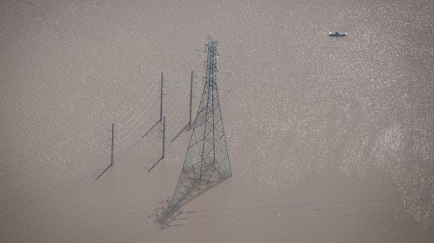 Power lines under water west of Ipswich during the flood.