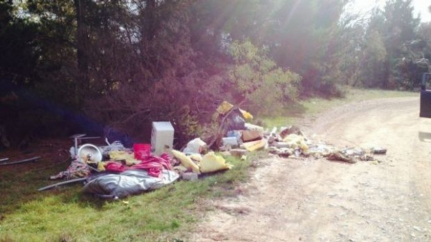 Another view of the household and other trash dumped near an entrance to the winery.