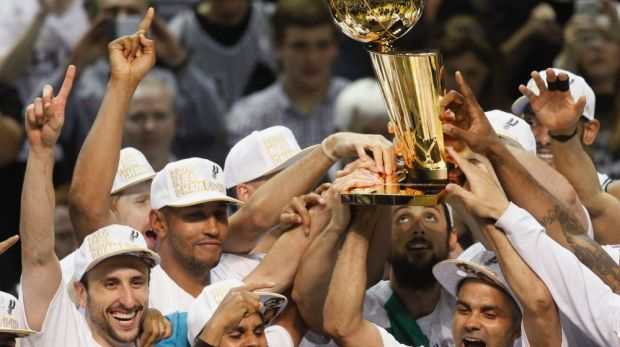 Champions: San Antonio with the Larry O'Brien trophy.