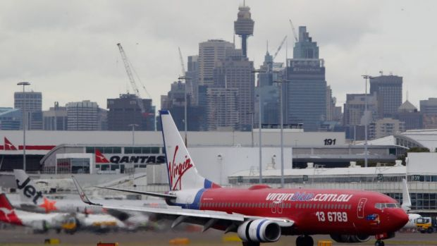 The Virgin flight was Sydney-bound when the passenger's unruly behaviour caused it to be turned around.