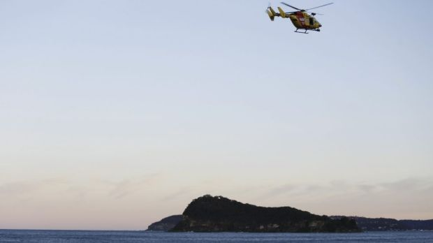 A helicopter searches for the boy missing from Pearl Beach.