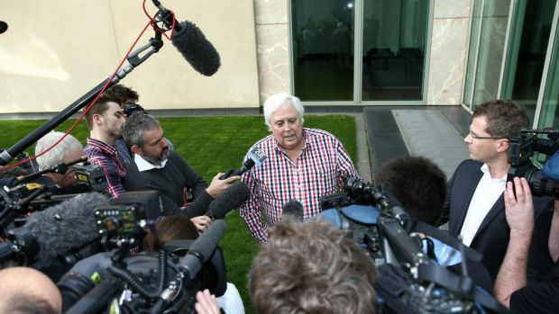 Palmer United Party leader Clive Palmer addresses the media in the Senate courtyard.