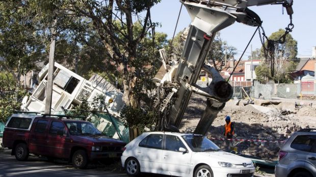 A toppled crane narrowly avoided cars in Newtown on Friday.