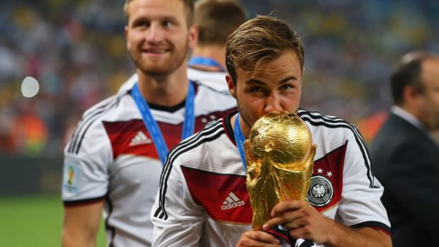 Bright future: Mario Goetze of Germany kisses the World Cup.