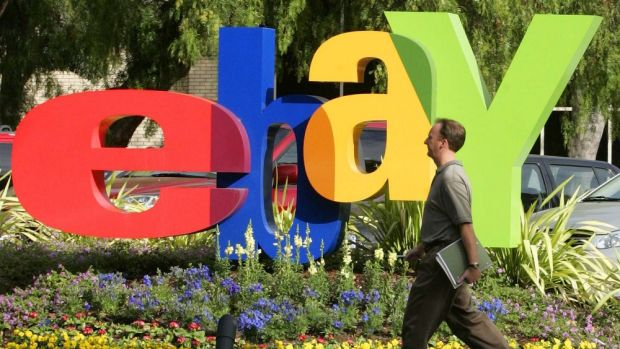 eBay is considering separating its two successful businesses, sources say.