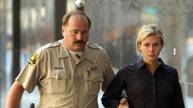 Kristin Rossum is escorted by a sheriff's deputy in 2002.