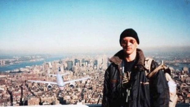 Hungarian man Péter Guzli posing on top of the World Trade Center as a hijacked plane approaches from behind. He added ...