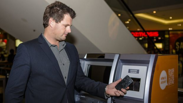 Australian Bitcoin ATMs director Robert Masters uses Canberra's first Two-Way Bitcoin ATM at Canberra Centre. Photo by: ...